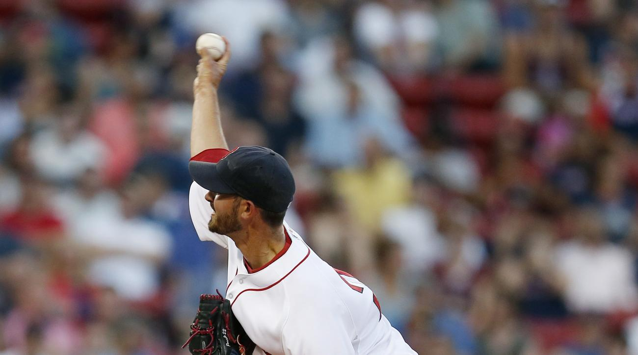 Boston Red Sox's Rick Porcello pitches during the first inning of a baseball game against the Chicago White Sox in Boston, Wednesday, July 29, 2015. (AP Photo/Michael Dwyer)