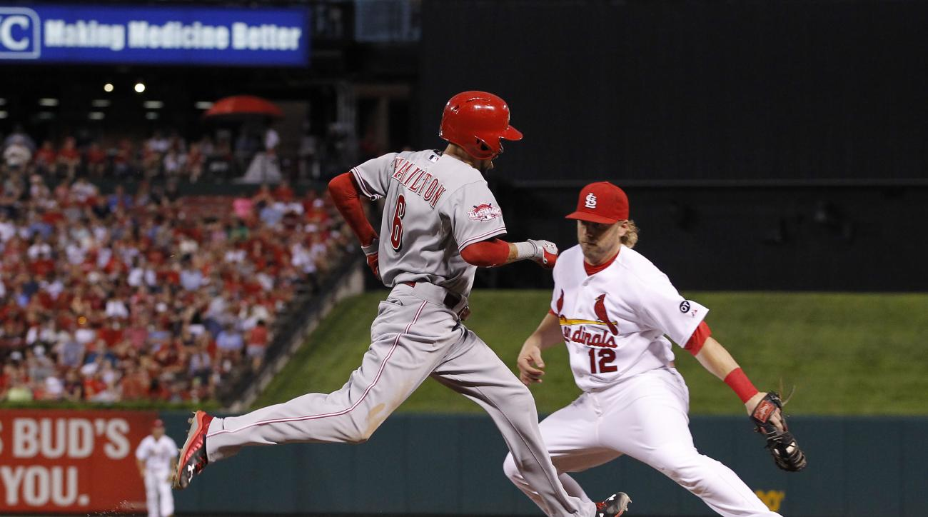 Cincinnati Reds' Billy Hamilton, left, is forced out at first base by St. Louis Cardinals' Mark Reynolds on a bunt attempt during the fifth inning of a baseball game ,Wednesday, July 29, 2015, in St. Louis. (AP Photo/Billy Hurst)