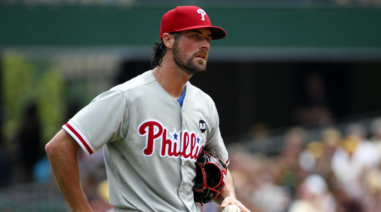 FILE - In this June 14, 2015, file photo, Philadelphia Phillies starting pitcher Cole Hamels collects himself on the mound during the fourth inning of a baseball game against the Pittsburgh Pirates in Pittsburgh. Two people familiar with the deal say the