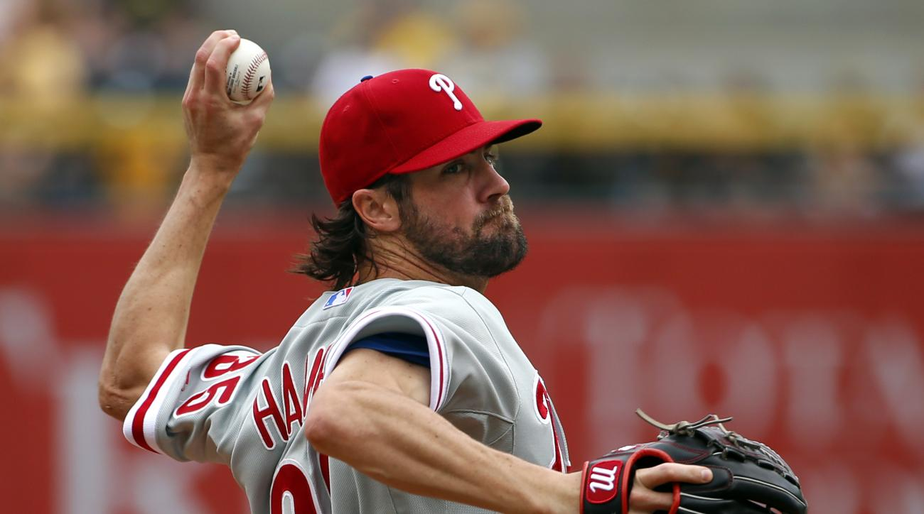 FILE - In this June 14, 2015, file photo, Philadelphia Phillies starting pitcher Cole Hamels delivers in the first inning of a baseball game against the Pittsburgh Pirates in Pittsburgh. Two people familiar with the deal say the Phillies have agreed to tr