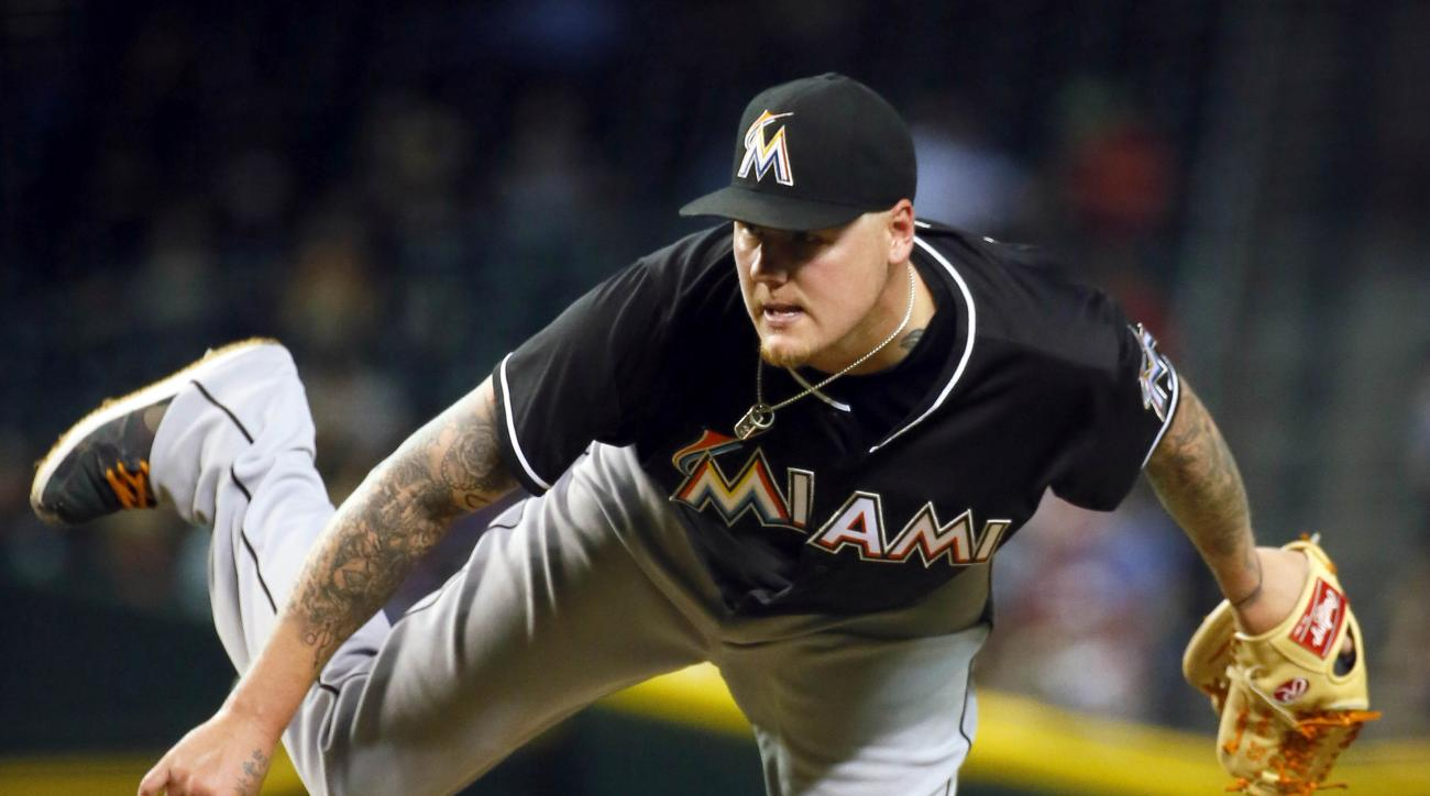 FILE - In this July 21, 2015, file photo, Miami Marlins starting pitcher Mat Latos throws during the seventh inning of a baseball game against the Arizona Diamondbacks in Phoenix. The first-place Los Angeles Dodgers have bolstered their pitching staff, ac