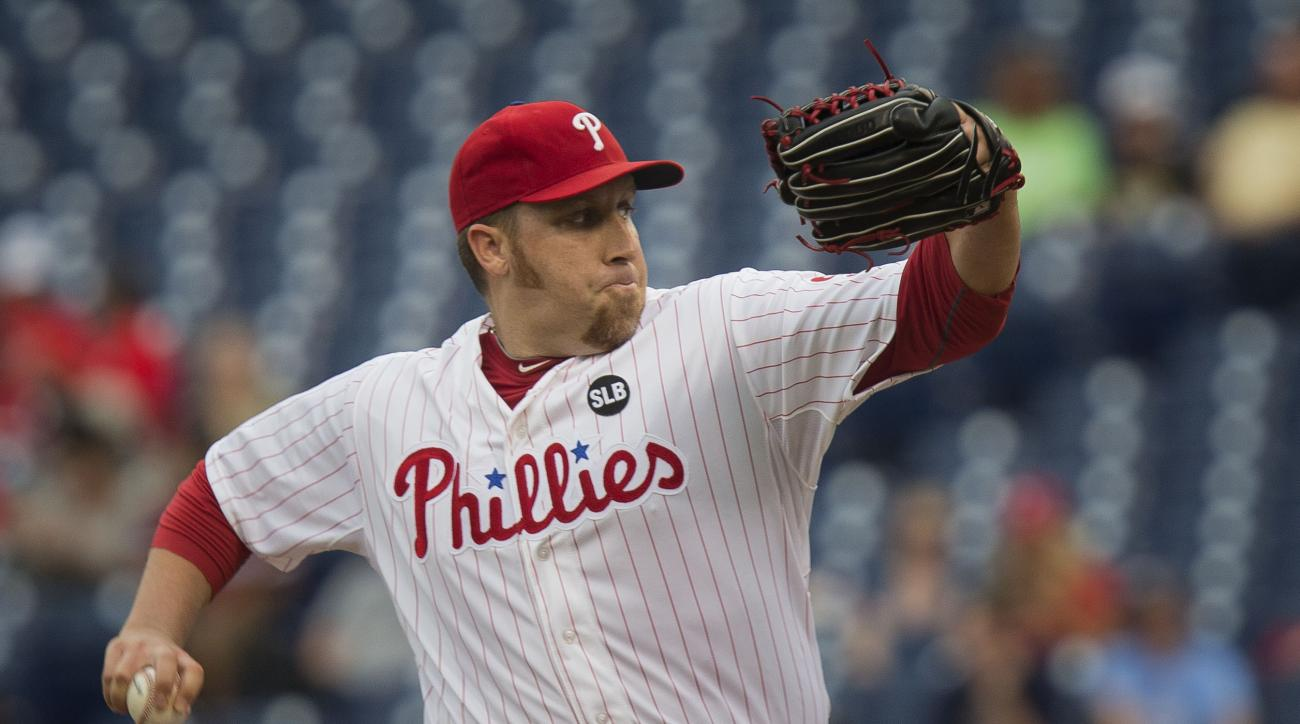 Philadelphia Phillies starting pitcher Aaron Harang throws in the first inning of a baseball game against the Atlanta Braves, Thursday, July 30, 2015, in Philadelphia. (AP Photo/Laurence Kesterson)