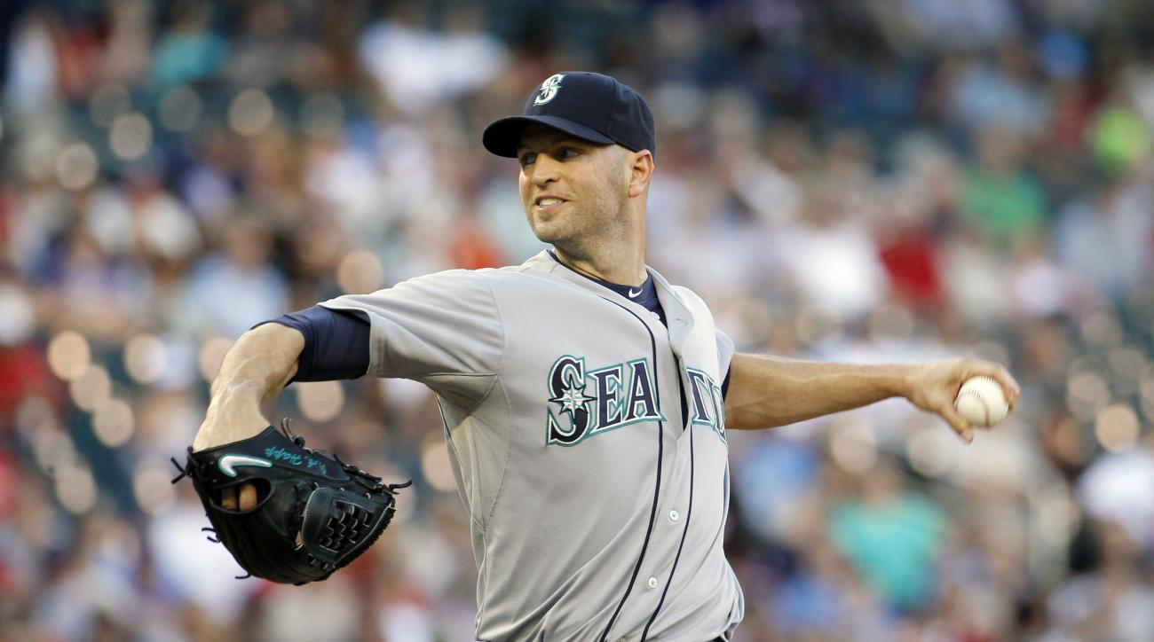 Seattle Mariners starting pitcher J.A. Happ delivers to the Minnesota Twins during the first inning of a baseball game in Minneapolis, Thursday, July 30, 2015. (AP Photo/Ann Heisenfelt)