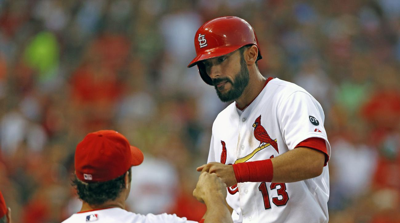 St. Louis Cardinals' Matt Carpenter is congratulated by manager Mike Matheny after hitting his second home run of the game during the fifth inning of a baseball game against the Colorado Rockies, Thursday, July 30, 2015, in St. Louis. (AP Photo/Billy Hurs