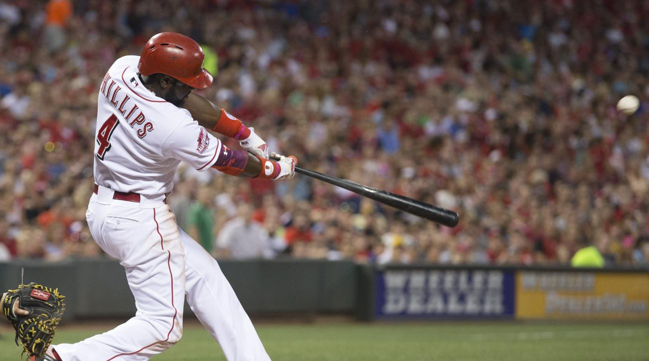 Cincinnati Reds' Brandon Phillips hits a three-run home run off Pittsburgh Pirates relief pitcher Deolis Guerra in the fifth inning of a baseball game, Thursday, July 30, 2015, in Cincinnati. (AP Photo/John Minchillo)