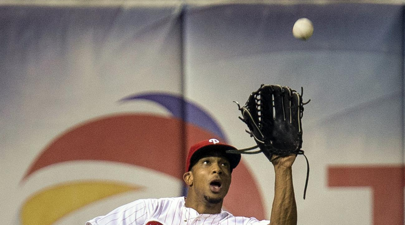 Philadelphia Phillies left fielder Ben Revere fields a pop fly by Atlanta Braves' Jace Peterson in the eighth inning of a baseball game, Thursday, July 30, 2015, in Philadelphia. The Phillies won 4-1. (AP Photo/Laurence Kesterson)