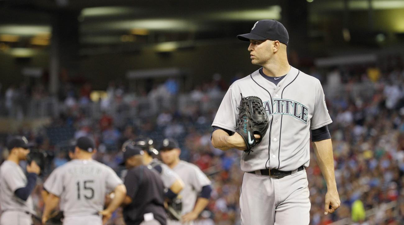 Seattle Mariners starting pitcher J.A. Happ leaves the mound after being replaced by Tom Wilhelmsen during the fourth inning of a baseball game against the Minnesota Twins in Minneapolis, Thursday, July 30, 2015. (AP Photo/Ann Heisenfelt)