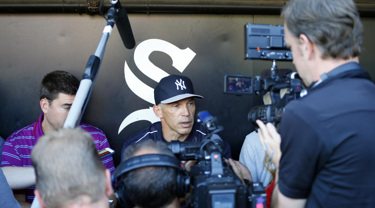 New York Yankees manager Joe Girardi, center, talks to reporters before a baseball game against the Chicago White Sox, Friday, July 31, 2015. (AP Photo/Jeff Haynes)