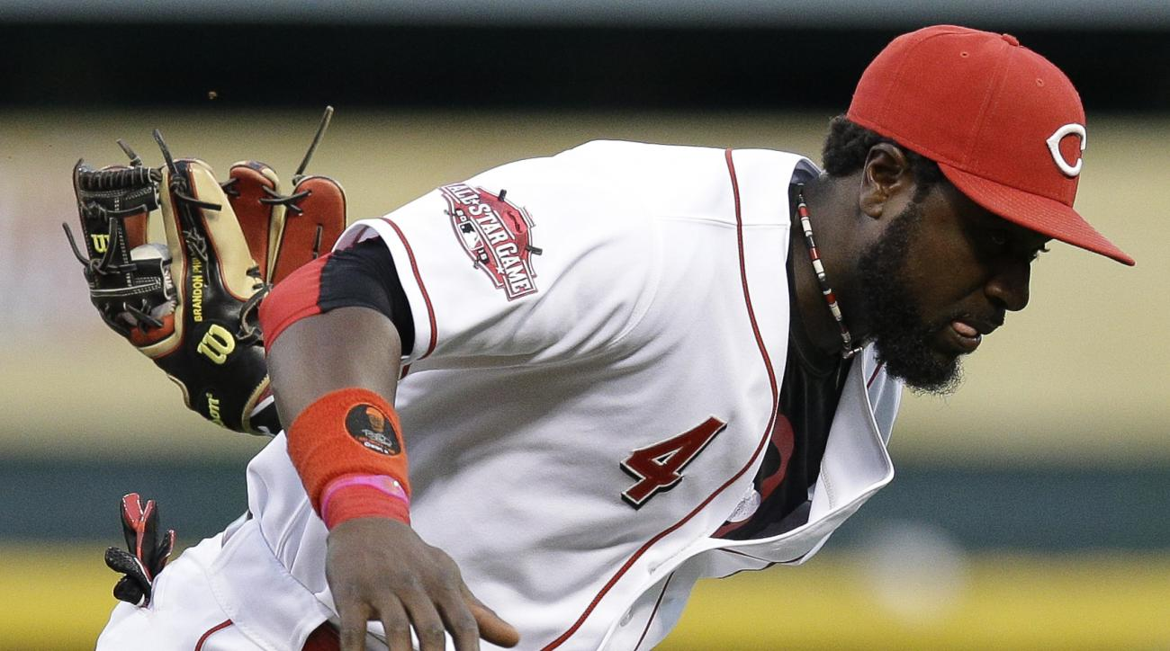 Cincinnati Reds second baseman Brandon Phillips catches out Pittsburgh Pirates' Aramis Ramirez on a line drive in the fifth inning of a baseball game, Friday, July 31, 2015, in Cincinnati. (AP Photo/John Minchillo)