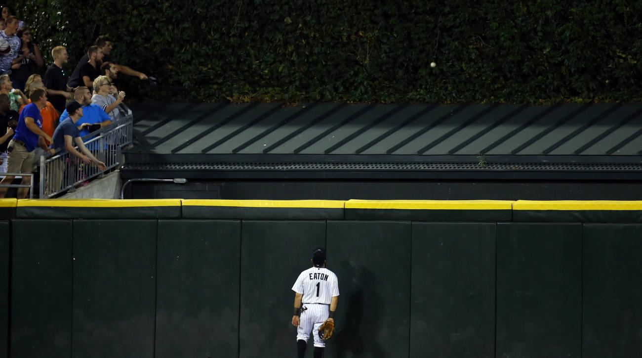 Chicago White Sox center fielder Adam Eaton (1) watches the home run ball of New York Yankees' Mark Teixeira clear the wall during the fourth inning of a baseball game in Chicago, Friday, July 31, 2015. (AP Photo/Jeff Haynes)