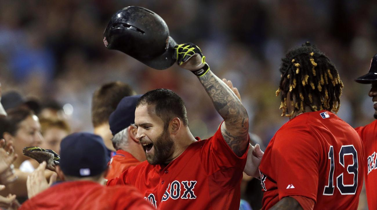 Boston Red Sox's Mike Napoli, center, celebrates his two-run home run during the seventh inning of a baseball game against the Tampa Bay Rays in Boston, Friday, July 31, 2015. The Red Sox won 7-5. (AP Photo/Michael Dwyer)