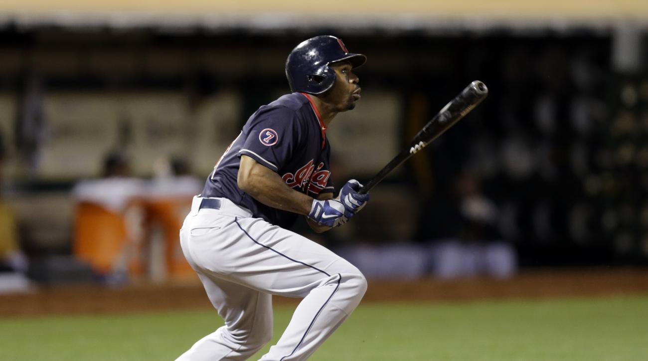 Cleveland Indians' Michael Bourn follows through on his RBI double against the Oakland Athletics' in the ninth inning of a baseball game Friday, July 31, 2015, in Oakland, Calif. (AP Photo/Ben Margot)