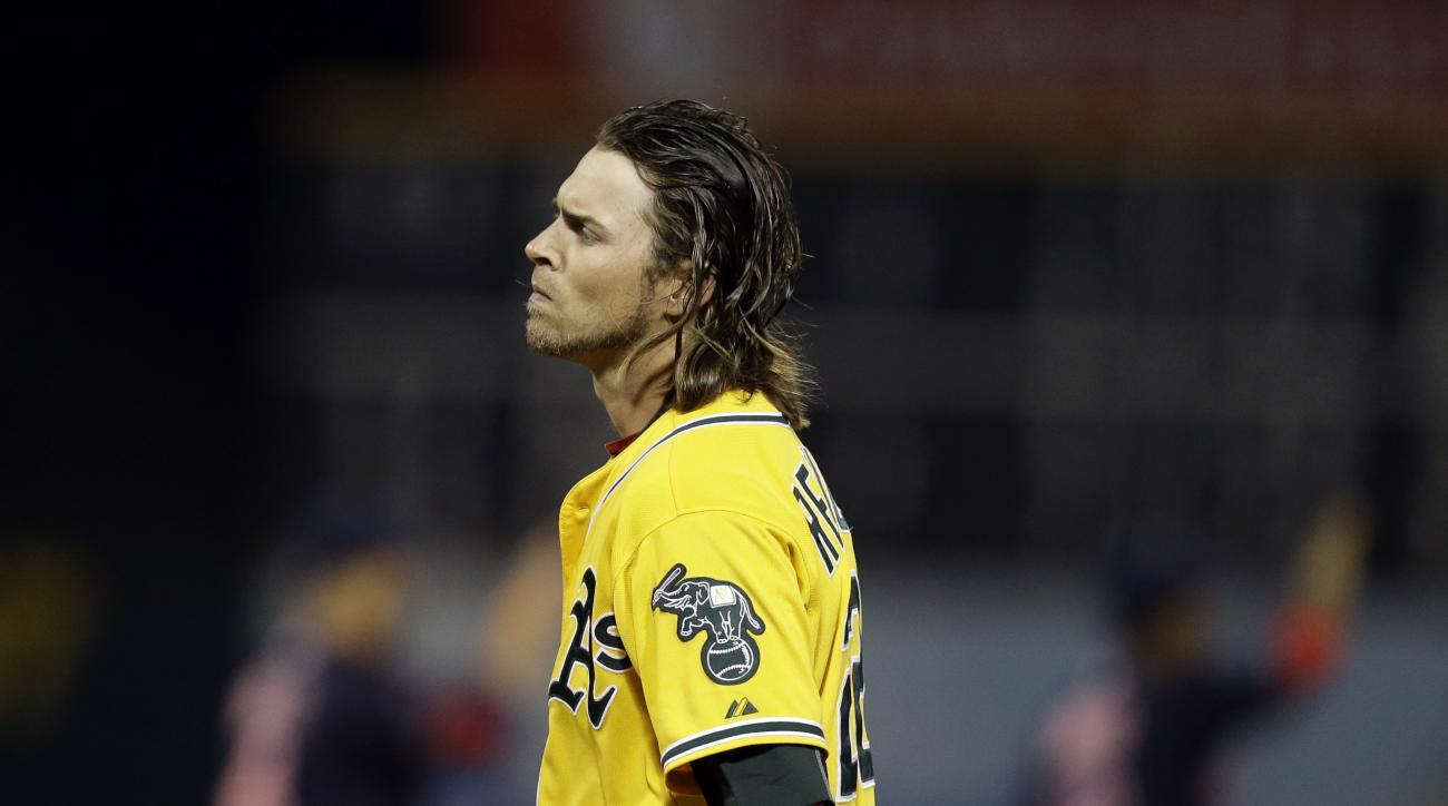 Oakland Athletics' Josh Reddick walks off the field after making the final out, giving the Cleveland Indians a 2-1 victory, at the end of a baseball game Friday, July 31, 2015, in Oakland, Calif. (AP Photo/Ben Margot)