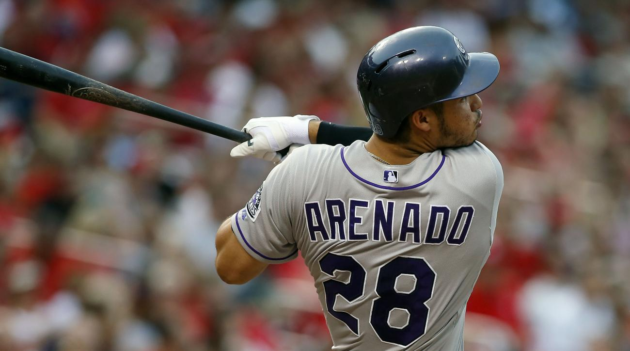 Colorado Rockies' Nolan Arenado follows through on a two run home run during the fourth inning of a baseball game against the St. Louis Cardinals Saturday, Aug. 1, 2015, in St. Louis. (AP Photo/Scott Kane)