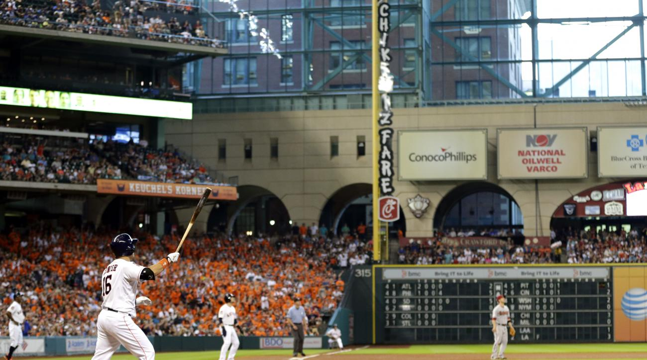 Houston Astros' Hank Conger (16) watches his grand slam against the Arizona Diamondbacks during the fourth inning of a baseball game Saturday, Aug. 1, 2015, in Houston. (AP Photo/David J. Phillip)