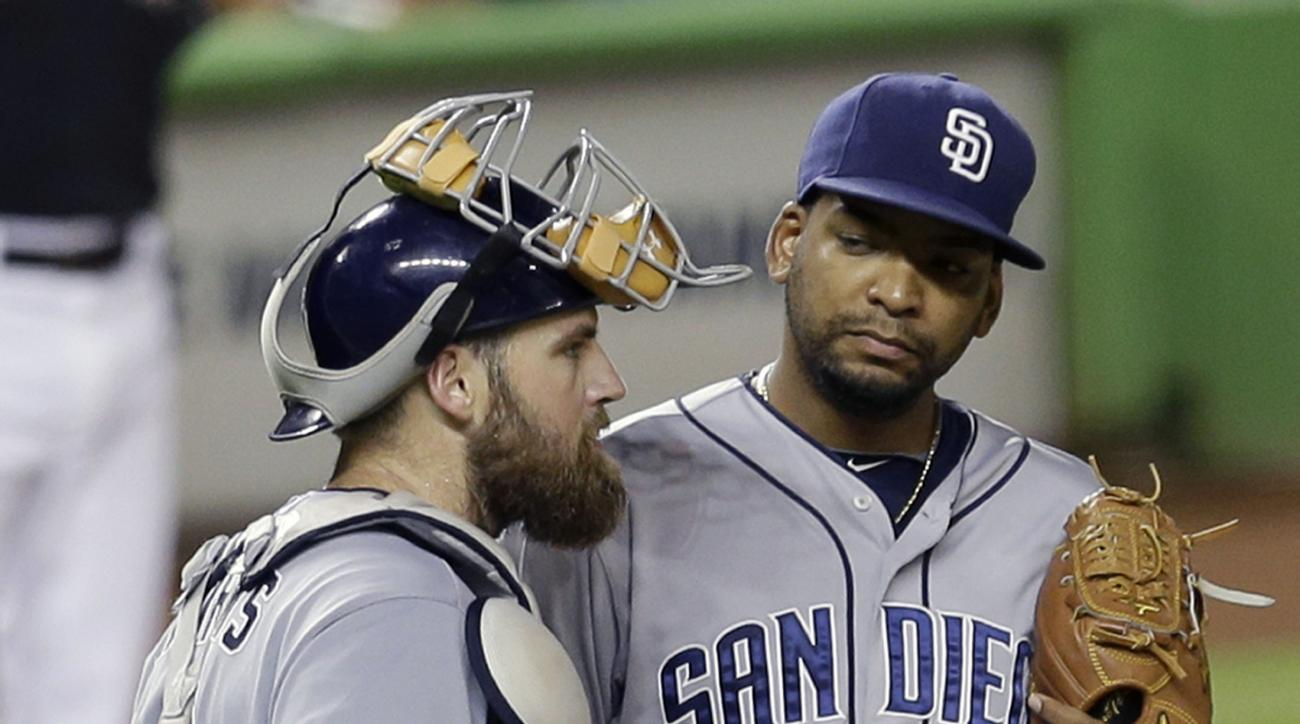 San Diego Padres catcher Derek Norris, left,  talks to pitcher Odrisamer Despaigne, right, after Miami Marlins' Adeiny Hechavarria's base hit in the fifth inning of a baseball game, Saturday, Aug. 1, 2015, in Miami. (AP Photo/Alan Diaz)