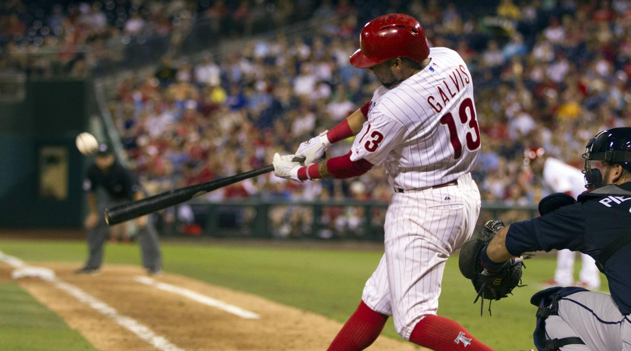 Philadelphia Phillies' Freddy Galvis hits a three-run home run during the sixth inning of a baseball game against the Atlanta Braves, Saturday, Aug. 1, 2015, in Philadelphia. (AP Photo/Chris Szagola)