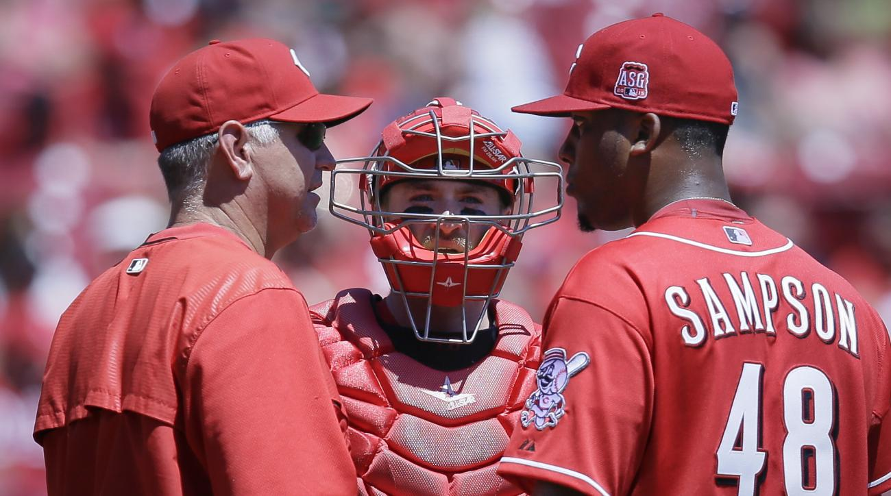 Cincinnati Reds pitching coach Jeff Pico, left, meets with starting pitcher Keyvius Sampson (48) and catcher Tucker Barnhart, center, in the third inning of a baseball game against the Pittsburgh Pirates, Sunday, Aug. 2, 2015, in Cincinnati. (AP Photo/Joh