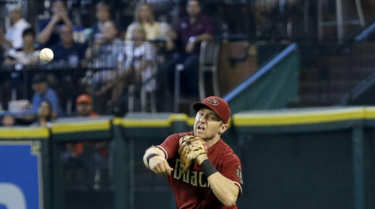Arizona Diamondbacks second baseman Cliff Pennington throws to first after fielding a ground ball hit by Houston Astros' Evan Gattis during the first inning of a baseball game, Sunday, Aug. 2, 2015, in Houston. Gattis was out at first on the play. (AP Pho
