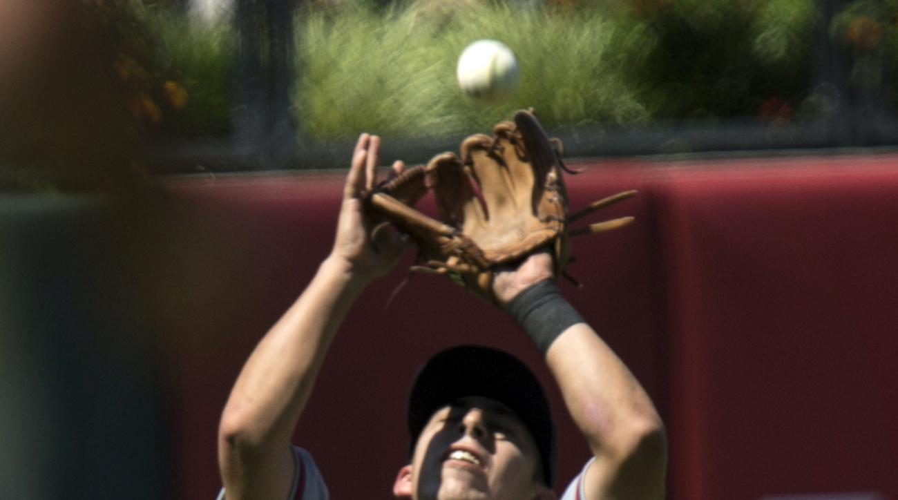 Atlanta Braves shortstop Daniel Castro fields a pop fly by Philadelphia Phillies' Cody Asche in the fourth inning of a baseball game, Sunday, Aug. 2, 2015, in Philadelphia. (AP Photo/Laurence Kesterson)