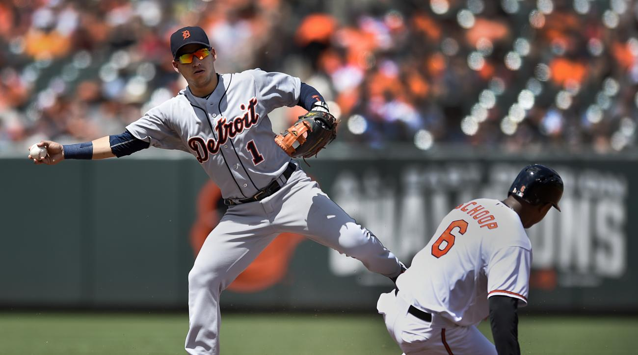 Baltimore Orioles' Jonathan Schoop is out at second on a force as Detroit Tigers shortstop Jose Iglesias covers on a ground ball hit by Orioles' Nolan Reimold during the third inning of a baseball game, Sunday, Aug. 2, 2015, in Baltimore. (AP Photo/Gail B