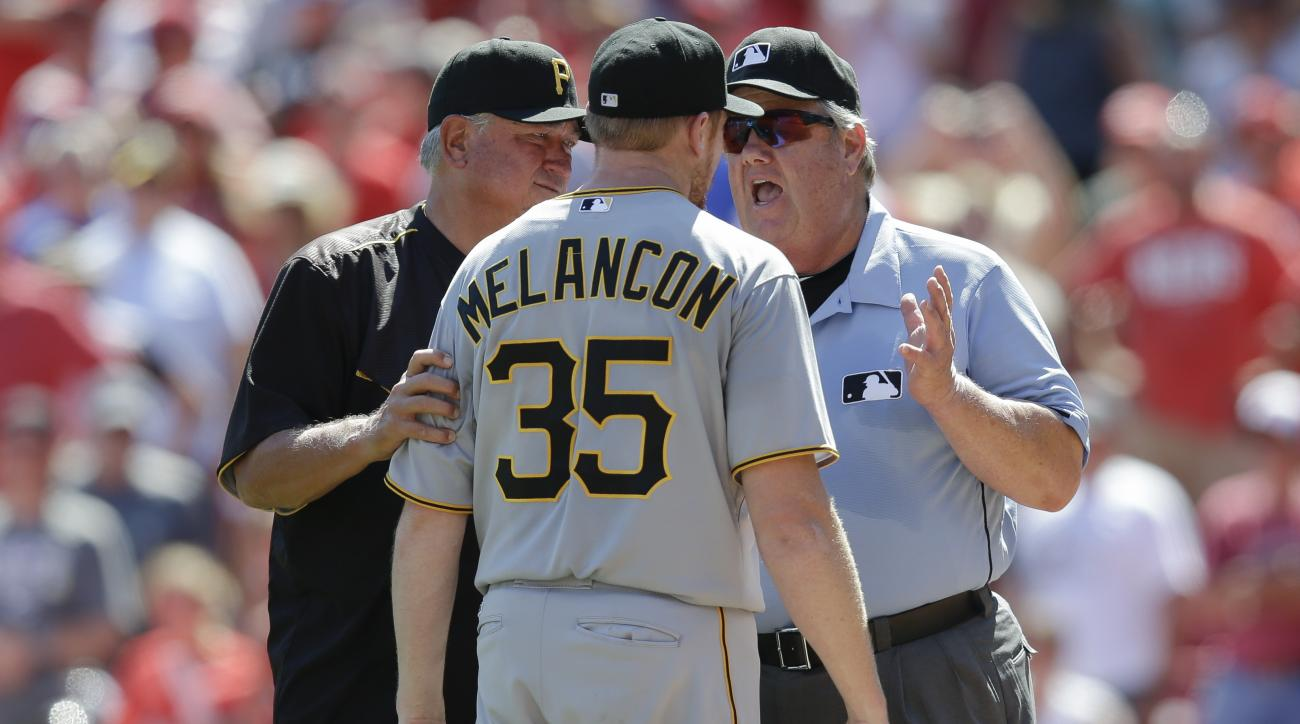 Pittsburgh Pirates pitcher Mark Melancon (35) and manager Clint Hurdle, left, argue with umpire Joe West, right, after being ejected for hitting Cincinnati Reds catcher Tucker Barnhart with a pitch in the ninth inning of a baseball game, Sunday, Aug. 2, 2