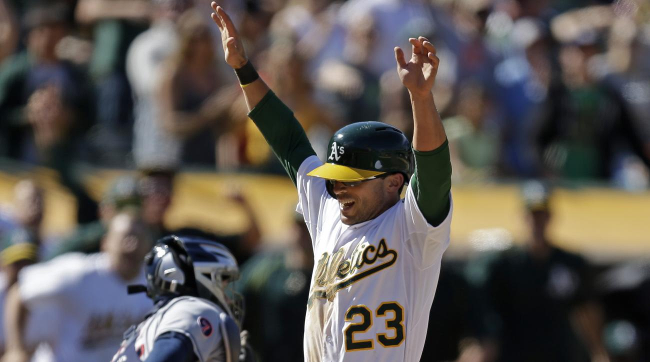 Oakland Athletics' Sam Fuld celebrates as he scores the game winning run in the tenth inning of a baseball game against the Cleveland Indians Sunday, Aug. 2, 2015, in Oakland, Calif.  The A's won, 2-1. (AP Photo/Ben Margot)