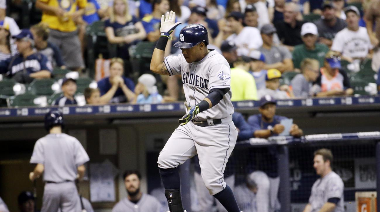 San Diego Padres' Yangervis Solarte celebrates as he runs home after hitting a three-run home run during the seventh inning of a baseball game against the Milwaukee Brewers Monday, Aug. 3, 2015, in Milwaukee. (AP Photo/Morry Gash)