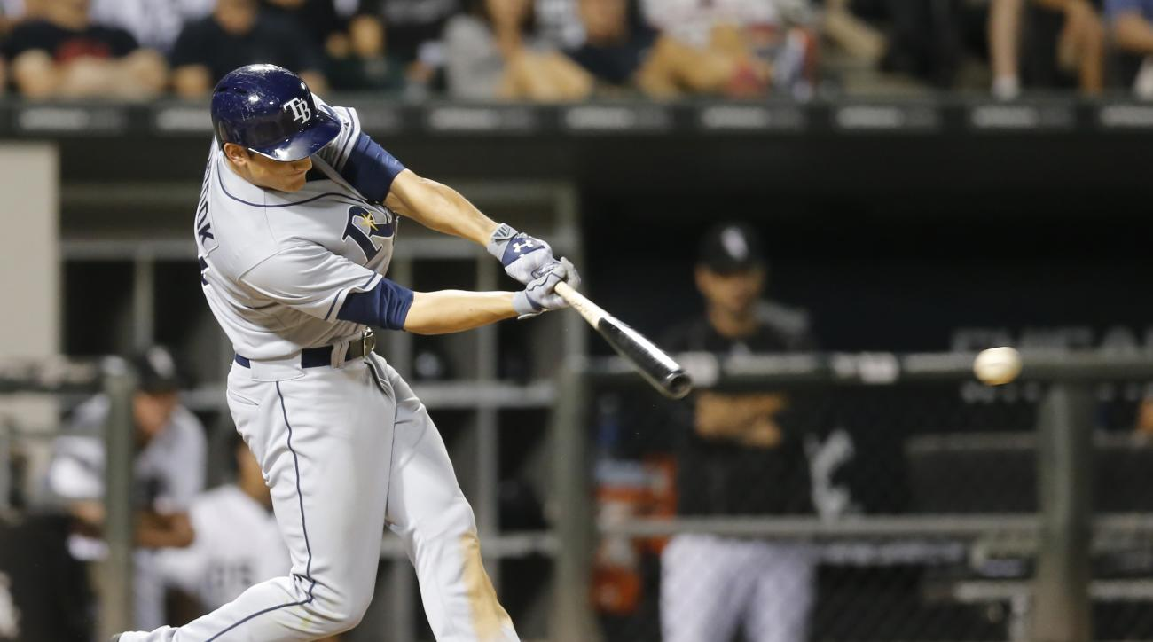 Tampa Bay Rays' Mikie Mahtook hits an RBI single off Chicago White Sox relief pitcher David Robertson, scoring Logan Forsythe, during the ninth inning of a baseball game Monday, Aug. 3, 2015, in Chicago. The Rays won off Mahtook's hit 5-4. (AP Photo/Charl