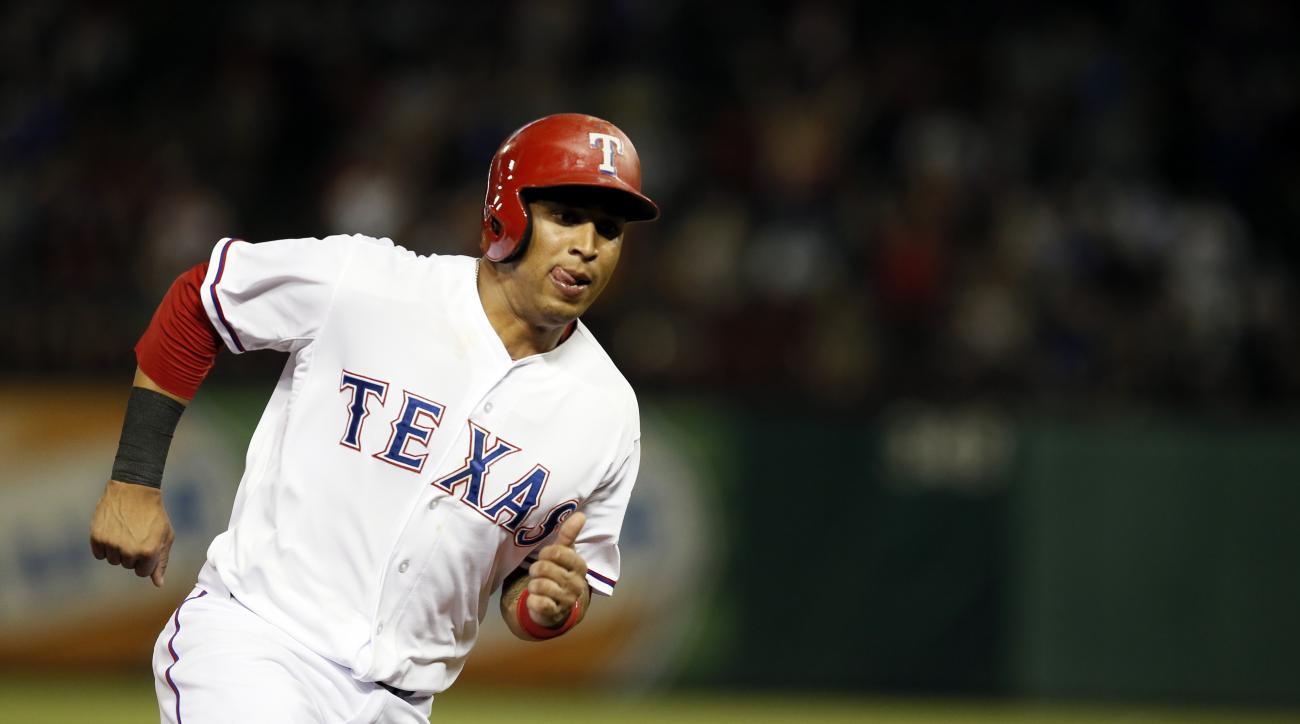 Texas Rangers' Leonys Martin sprints home scoring on a Josh Hamilton single in the ninth inning of a baseball game Thursday, July 30, 2015, in Arlington, Texas. (AP Photo/Tony Gutierrez)