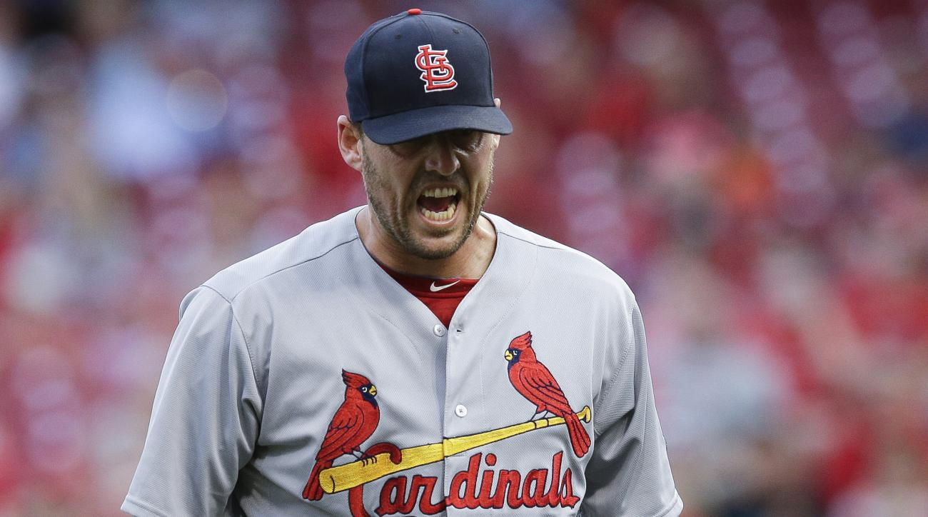 St. Louis Cardinals starting pitcher John Lackey reacts after giving up three runs to the Cincinnati Reds during the first inning of a baseball game Tuesday, Aug. 4, 2015, in Cincinnati. (AP Photo/John Minchillo)