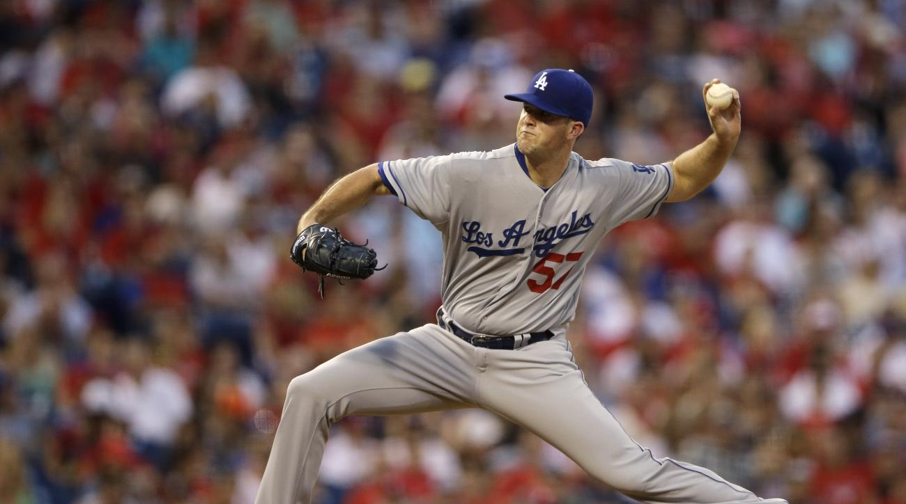 Los Angeles Dodgers' Alex Wood pitches during the third inning of a baseball game against the Philadelphia Phillies, Tuesday, Aug. 4, 2015, in Philadelphia. (AP Photo/Matt Slocum)