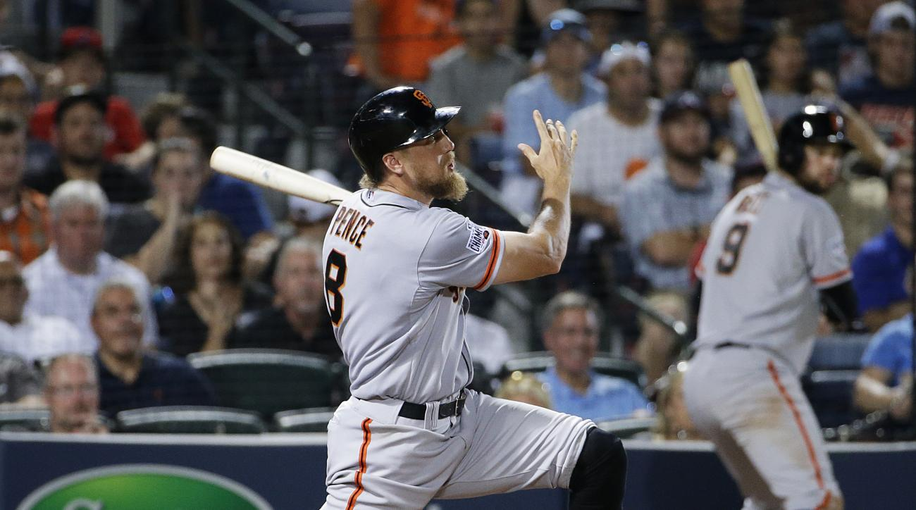 San Francisco Giants' Hunter Pence watches his three-run home run during the eighth inning of a baseball game against the Atlanta Braves on Tuesday, Aug. 4, 2015, in Atlanta. (AP Photo/David Goldman)