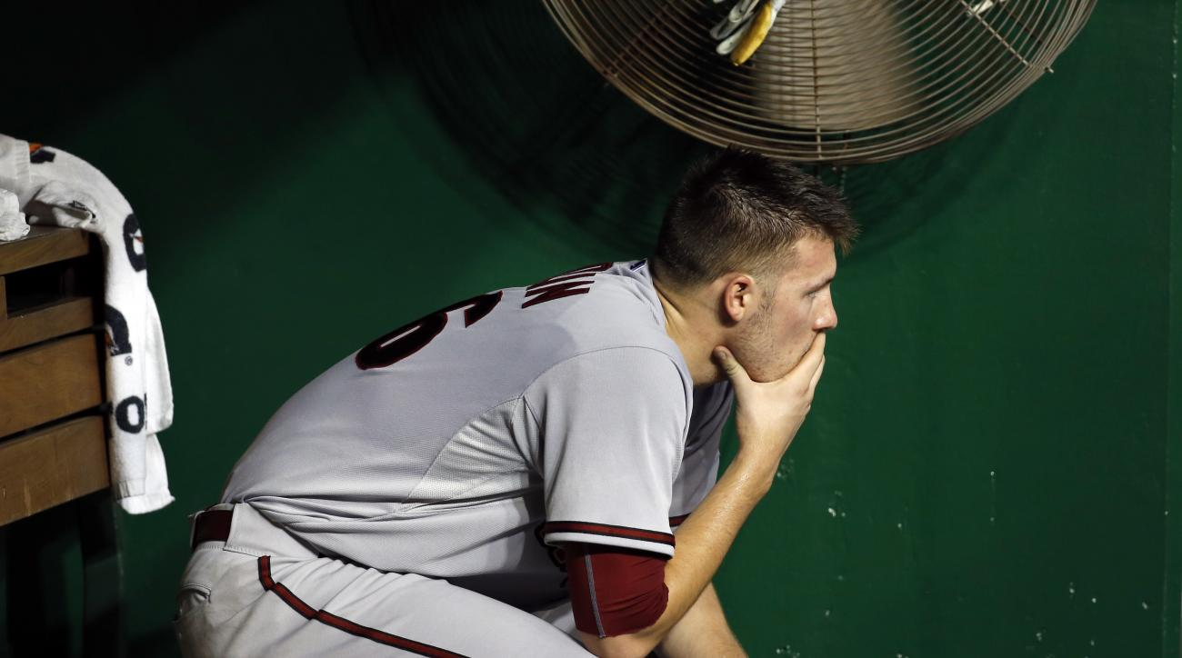 Arizona Diamondbacks starting pitcher Patrick Corbin (46) sits in the dugout after being relieved during the second inning of a baseball game against the Washington Nationals at Nationals Park, Tuesday, Aug. 4, 2015, in Washington. (AP Photo/Alex Brandon)