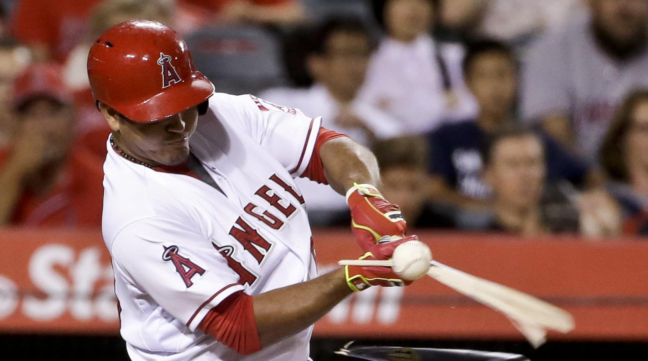 Los Angeles Angels' Carlos Perez breaks his bat and grounds out against the Cleveland Indians to end the 11th inning of a baseball game in Anaheim, Calif., Tuesday, Aug. 4, 2015. (AP Photo/Chris Carlson)