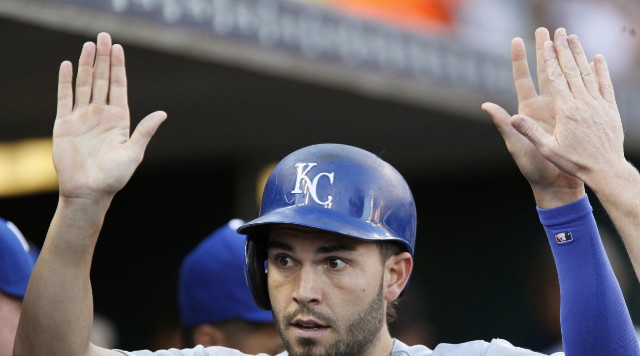 Kansas City Royals' Eric Hosmer celebrates after scoring against the Detroit Tigers on a triple by Kendrys Morales during the fourth inning of a baseball game at Comerica Park, Wednesday, Aug. 5, 2015 in Detroit. (AP Photo/Duane Burleson)