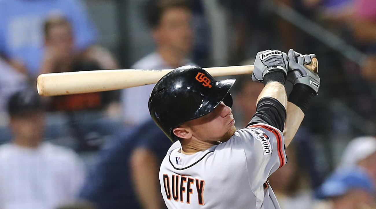 San Francisco Giants third baseman Matt Duffy (5) follows through on a two-run double in the seventh inning of a baseball game against the Atlanta Braves, Wednesday, Aug. 5, 2015, in Atlanta. (AP Photo/John Bazemore)