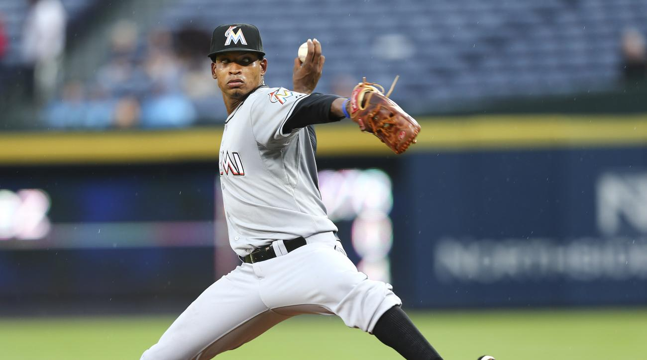 Miami Marlins starting pitcher Jose Urena works in the first inning of a baseball game against the Atlanta Braves Thursday, Aug. 6, 2015, in Atlanta. (AP Photo/John Bazemore)