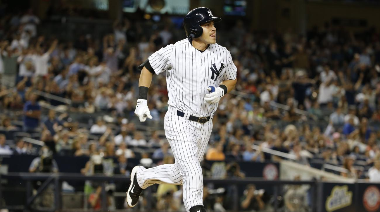 New York Yankees' Jacoby Ellsbury runs on his seventh-inning solo home run in a baseball game against the Boston Red Sox at Yankee Stadium in New York, Thursday, Aug. 6, 2015. (AP Photo/Kathy Willens)