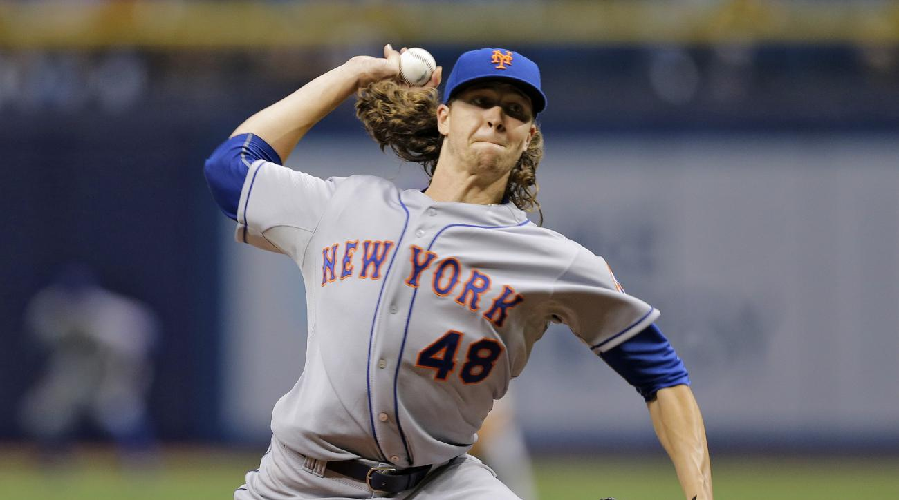 New York Mets starting pitcher Jacob deGrom delivers to the Tampa Bay Rays during the first inning of an interleague baseball game Friday, Aug. 7, 2015, in St. Petersburg, Fla. (AP Photo/Chris O'Meara)