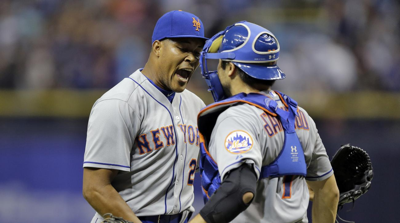 New York Mets relief pitcher Jeurys Familia, left, celebrates with catcher Travis d'Arnaud after closing out the Tampa Bay Rays during the ninth inning of an interleague baseball game Friday, Aug. 7, 2015, in St. Petersburg, Fla. The Mets won the game 4-3