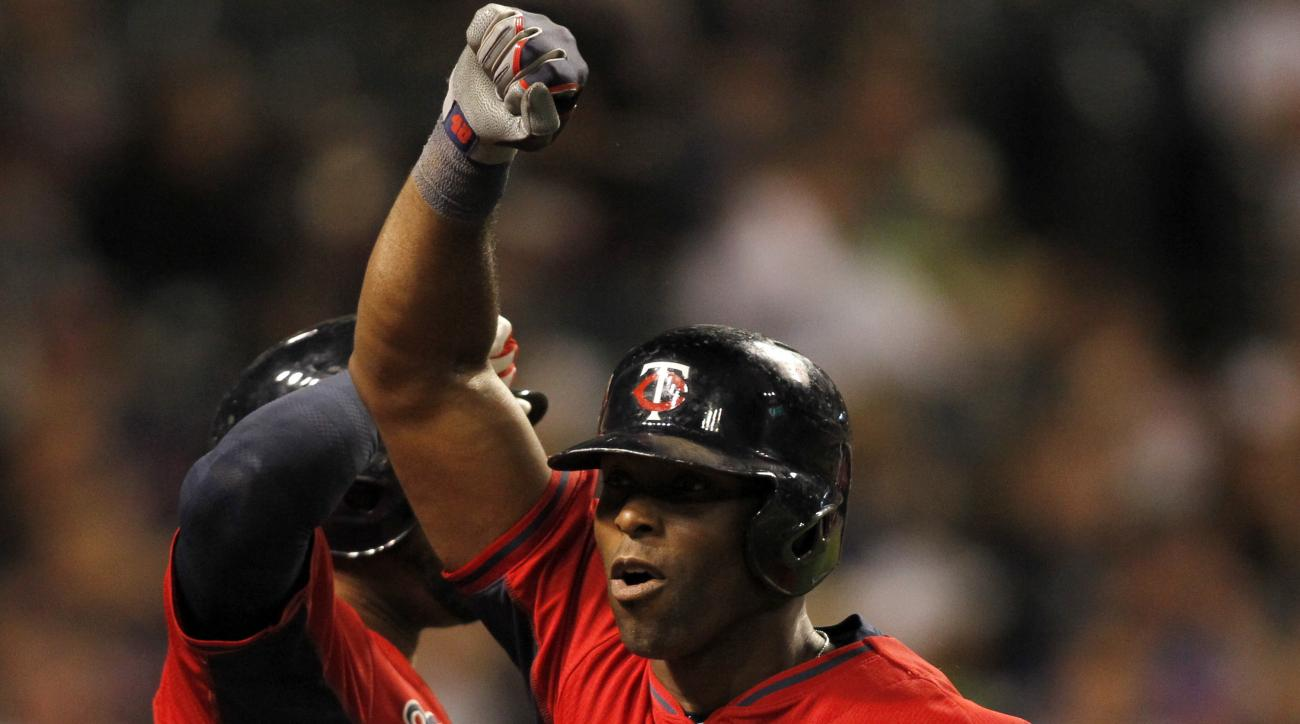 Minnesota Twins Tori Hunter (48) celebrates with teammate Aaron Hicks after hitting a go-ahead solo home run in the ninth inning of a baseball game against the Cleveland Indians, Friday, Aug. 7, 2015, in Cleveland. (AP Photo/Aaron Josefczyk