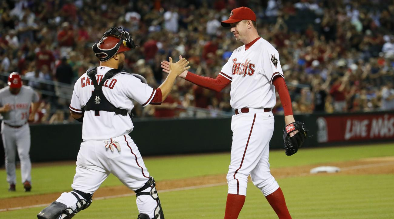 Arizona Diamondbacks relief pitcher Brad Ziegler, right, is greeted by catcher Welington Castillo after a baseball game against the Cincinnati Reds, Friday, Aug. 7, 2015, in Phoenix. The Diamondbacks won 2-0. (AP Photo/Matt York)