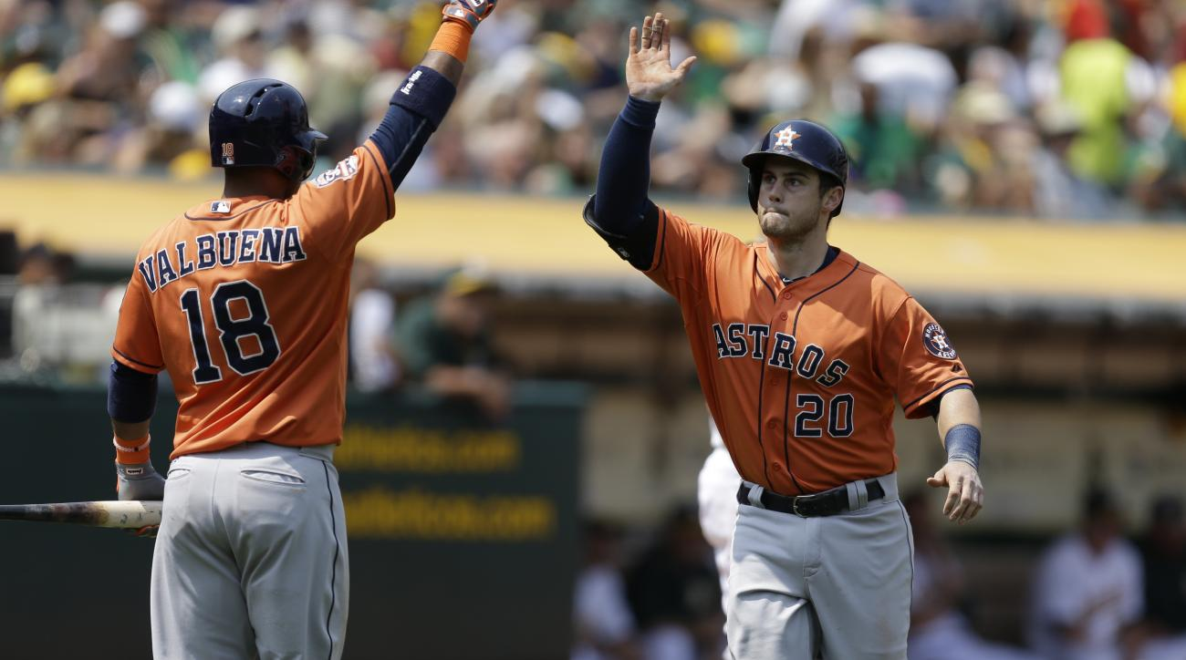Houston Astros' Preston Tucker, right, is congratulated by Luis Valbuena (18) after hitting a home run off Oakland Athletics' Jesse Chavez in the fifth inning of a baseball game Saturday, Aug. 8, 2015, in Oakland, Calif. (AP Photo/Ben Margot)