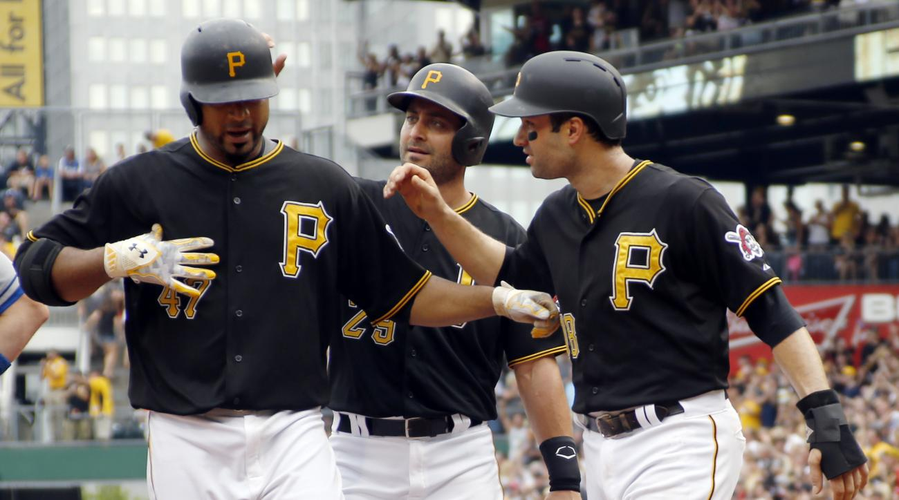Pittsburgh Pirates starting pitcher Francisco Liriano (47) is greeted by teammates Neil Walker (18) and Francisco Cervelli (29) after driving them in with a three-run home run in the second inning of a baseball game against the Los Angeles Dodgers, Saturd