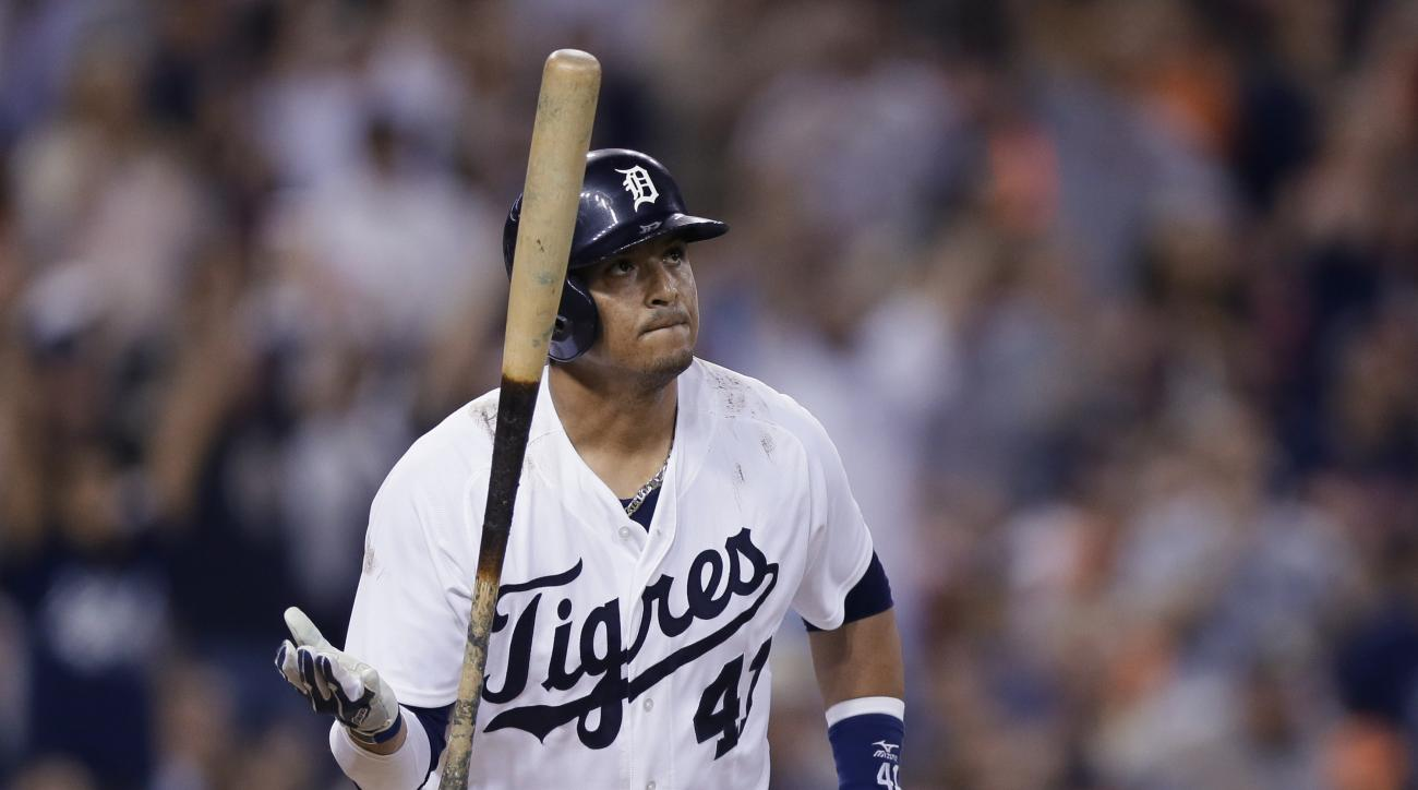 Detroit Tigers designated hitter Victor Martinez watches the path of his two-run home run to right field during the seventh inning of a baseball game against the Boston Red Sox, Saturday, Aug. 8, 2015, in Detroit. (AP Photo/Carlos Osorio)