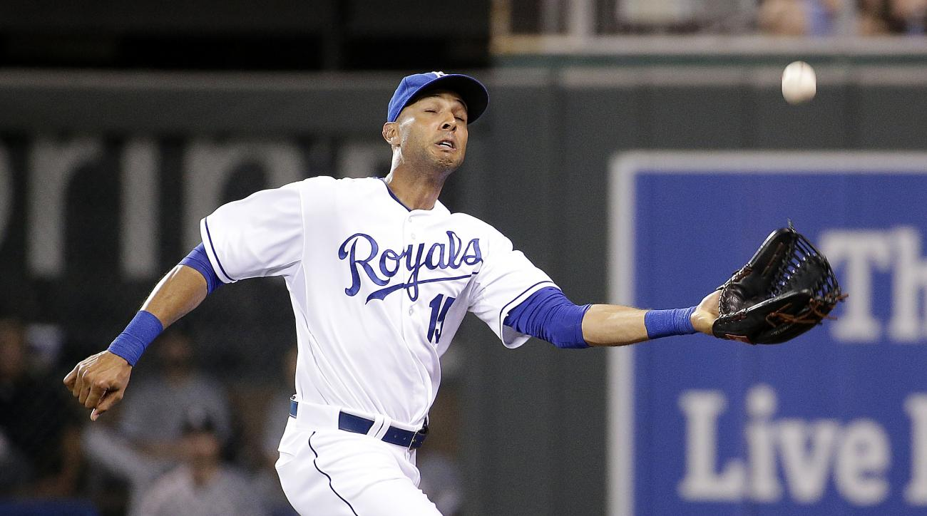 Kansas City Royals right fielder Alex Rios catches a fly ball for the out on Chicago White Sox's Geovany Soto during the eighth inning of a baseball game Saturday, Aug. 8, 2015, in Kansas City, Mo. (AP Photo/Charlie Riedel)