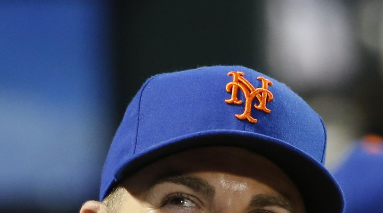 New York Mets David Wright is back in uniform as he watches from the dugout during a baseball game against the San Diego Padres in New York, Tuesday, July 28, 2015. (AP Photo/Kathy Willens)