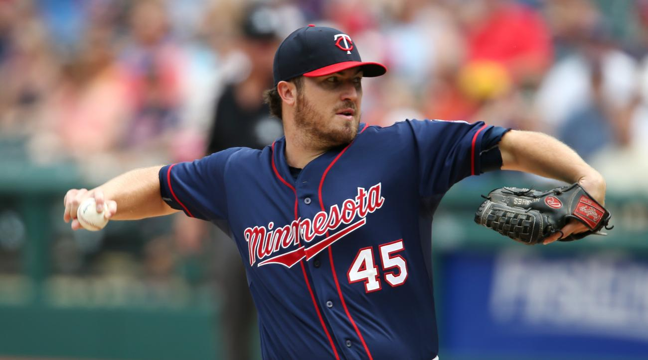 Minnesota Twins starting pitcher Phil Hughes throws to Cleveland Indians' Francisco Lindor during the first inning of a baseball game, Sunday, Aug. 9, 2015, in Cleveland. (AP Photo/Ron Schwane)