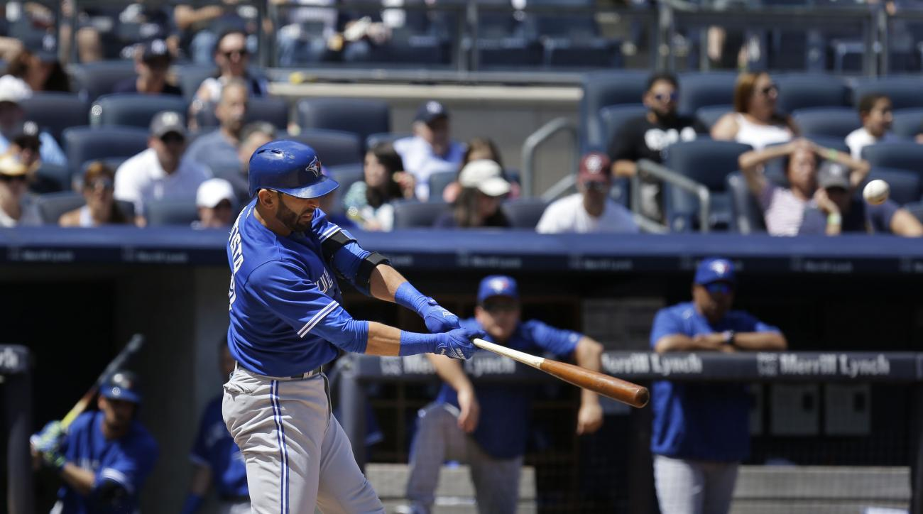 Toronto Blue Jays' Jose Bautista hits a solo home run during the fourth inning of the baseball game against the New York Yankees at Yankee Stadium, Sunday, Aug. 9, 2015, in New York. (AP Photo/Seth Wenig)